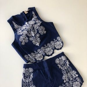 Royal blue shorts and top with white embroidery